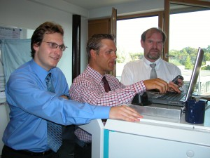 Mark Hakim, Dr Dieter Kreuer and Axel C. Voigt (lefto right) present the first AIS handover test system in 2004
