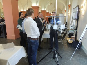 Qosmotec's Sales Partner Ferdinand Schuber demonstrates the need for reliable Car2Car Communication testing.